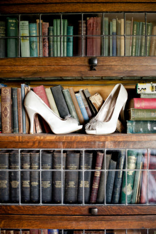 bride's shoes with antique books