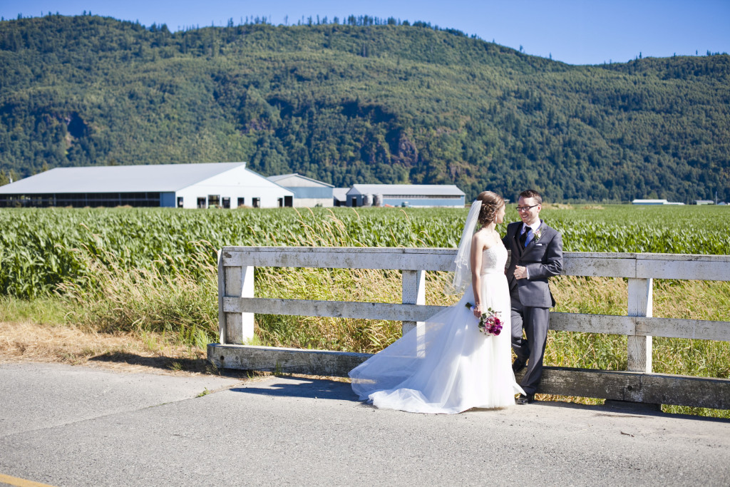 bride and groom on road with mountains