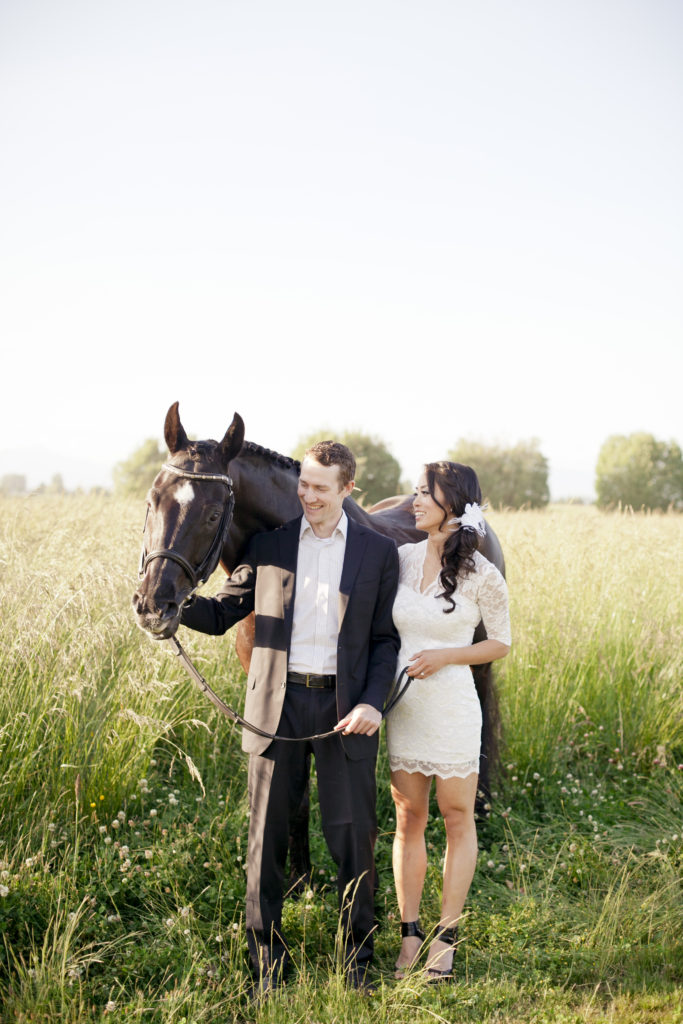 engagement photos couple in field with horse