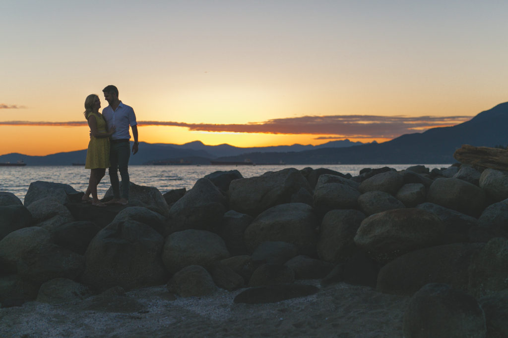 english bay engagement photos at sunset