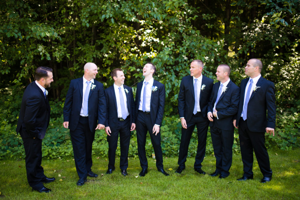 groomsmen having fun before wedding ceremony