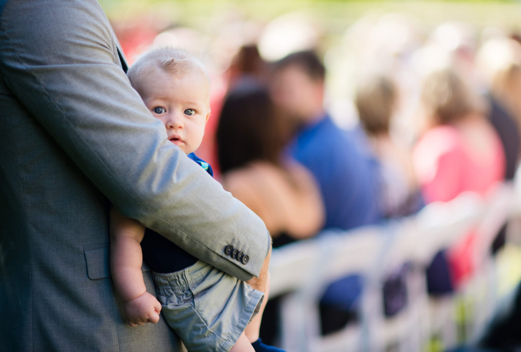 cute baby at wedding ceremony