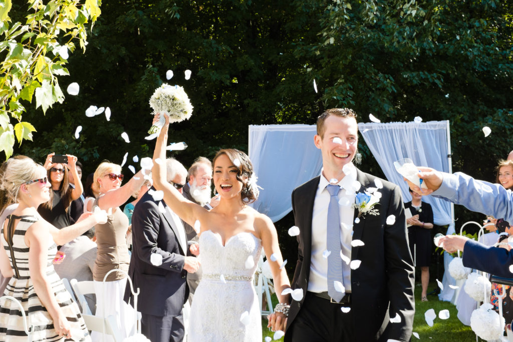 port moody wedding ceremony recessional with happy couple and petals