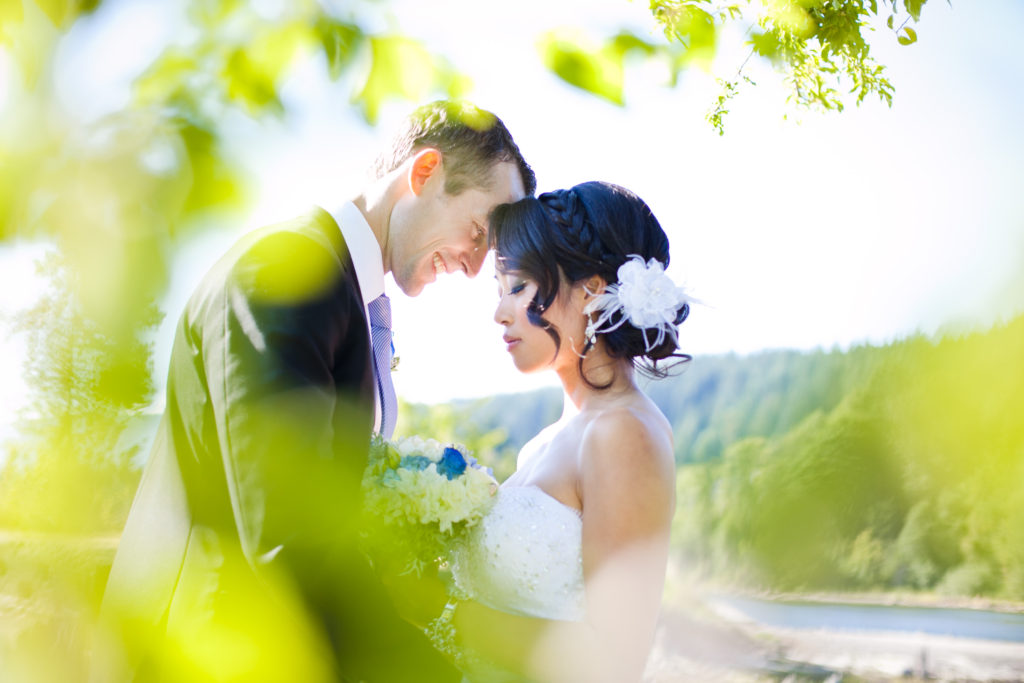 couples portrait with foreground foliage port moody wink photography