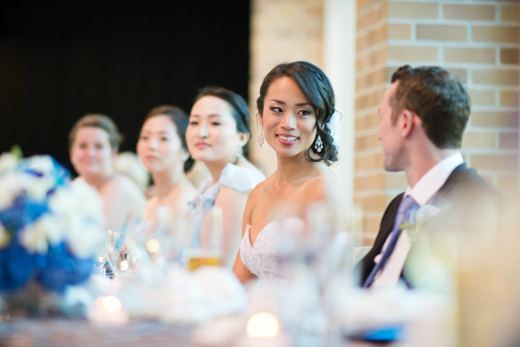 bride and groom at head table at port moody wedding