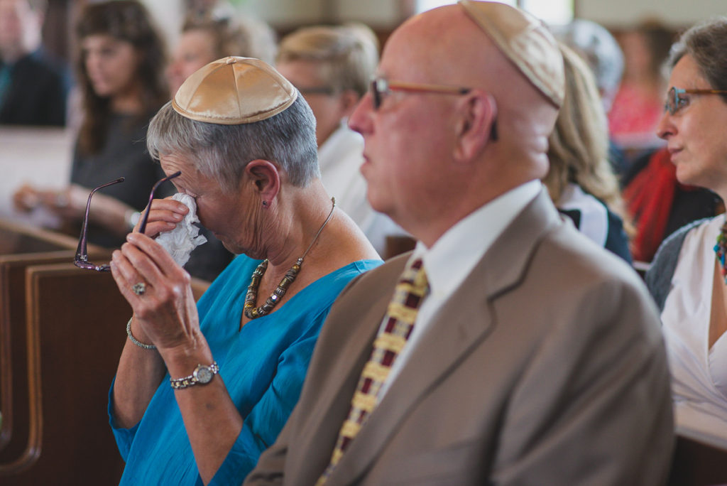 mother of the bride crying during jewish wedding ceremony vancouver