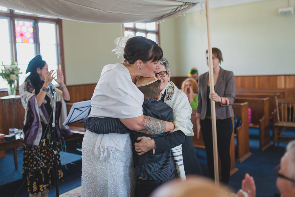 couple hugging son after wedding ceremony vancouver