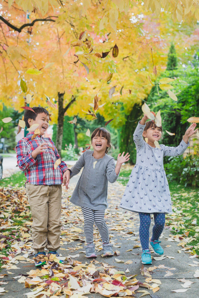 east vancouver family session kids playing in fall leaves