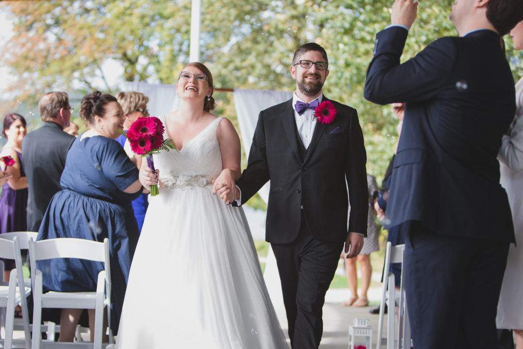 Wedding ceremony exit at Rocky Point Park beer themed wedding by Port Moody wedding Photographer Wink Photography