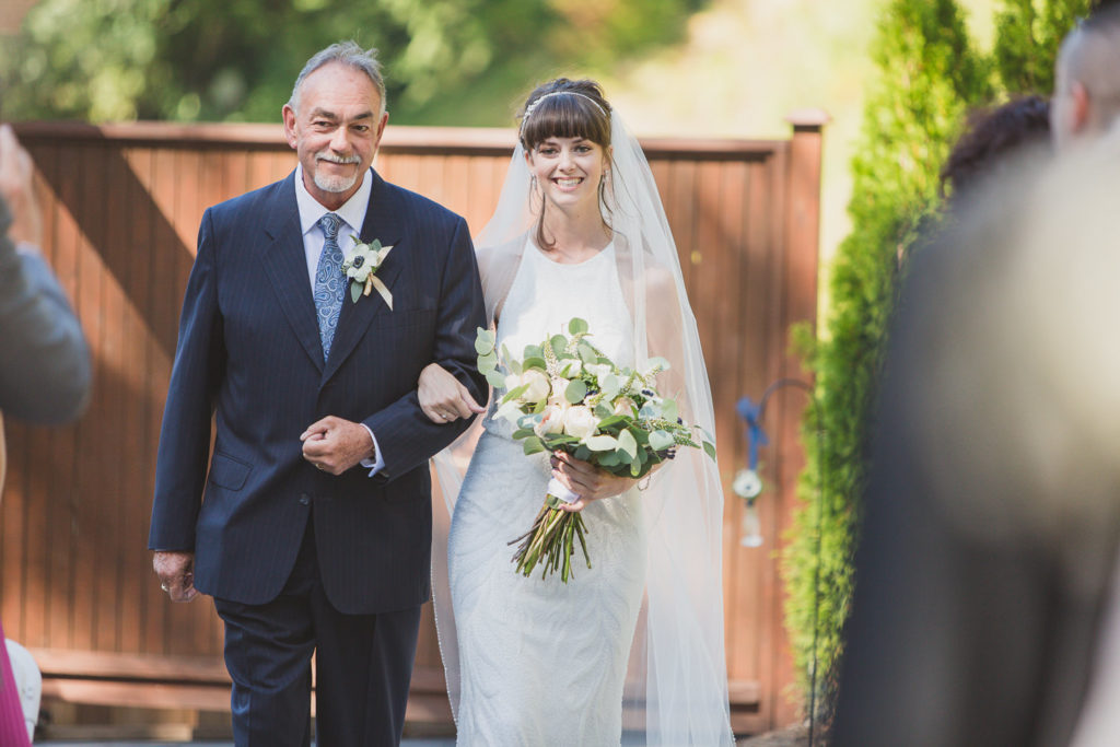 Bride coming down the aisle with dad at Sea to Sky wedding