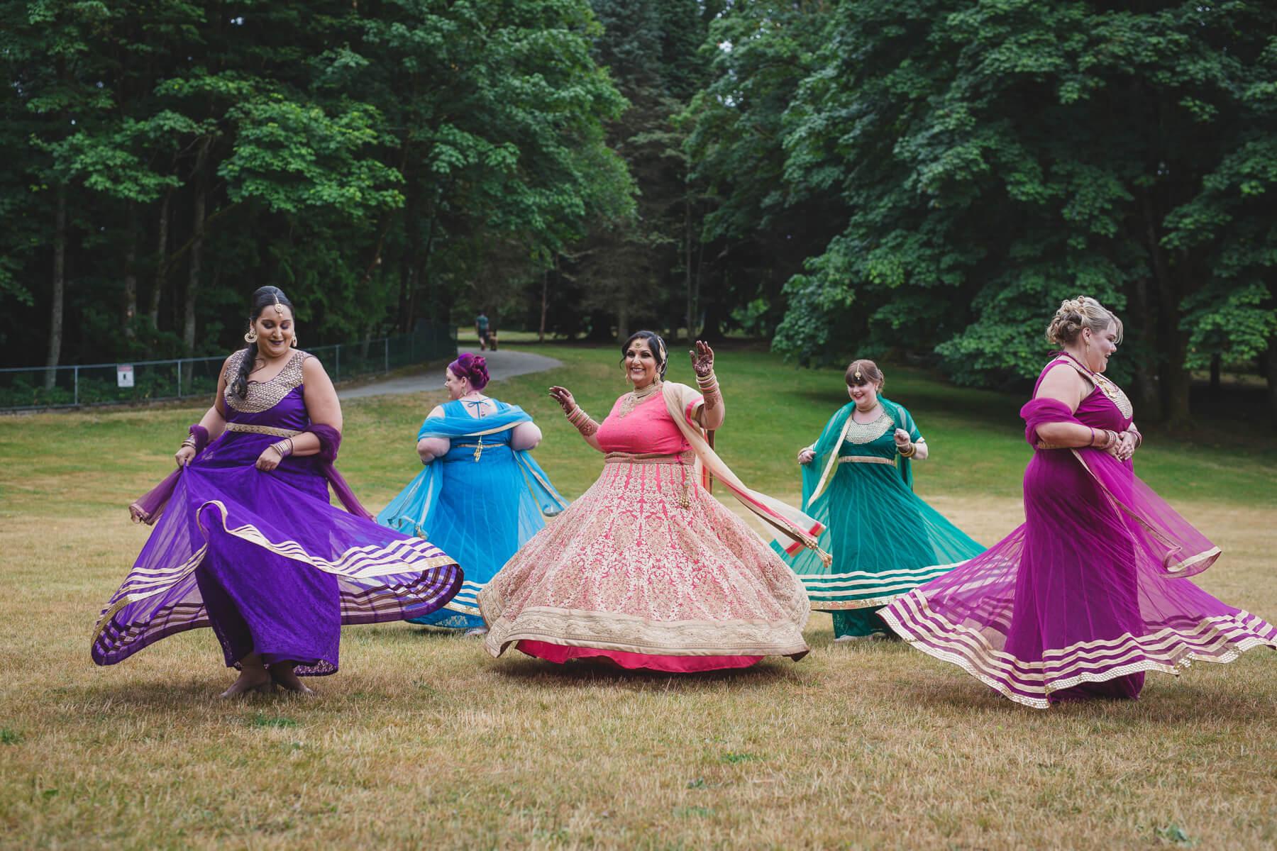 indian bridesmaids spinning portrait