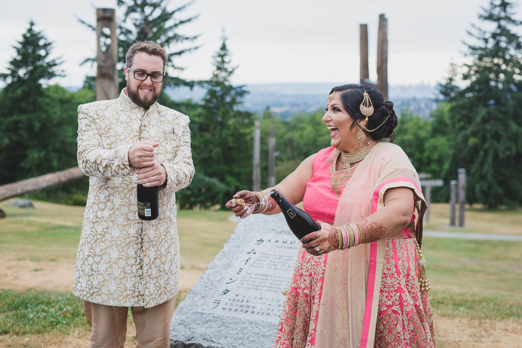 quirky bride and groom champagne pop at vancouver wedding